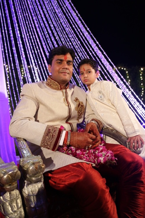 The handsome groom Lalit with his young nephew.